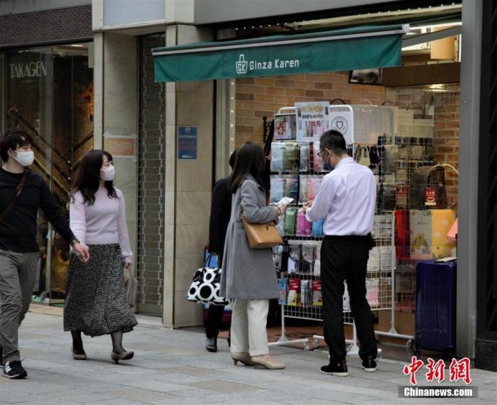 【蜗牛棋牌】日本单日新增新冠病例首超两千 东京将上调警戒级别