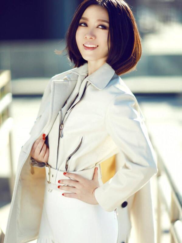 【蜗牛棋牌】姚贝娜 中国内地流行乐女歌手美照分享及个人资料